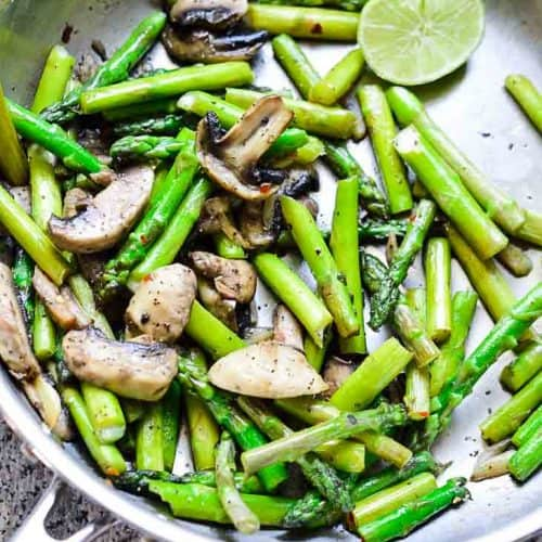 Sauteeing mushrooms and asparagus image