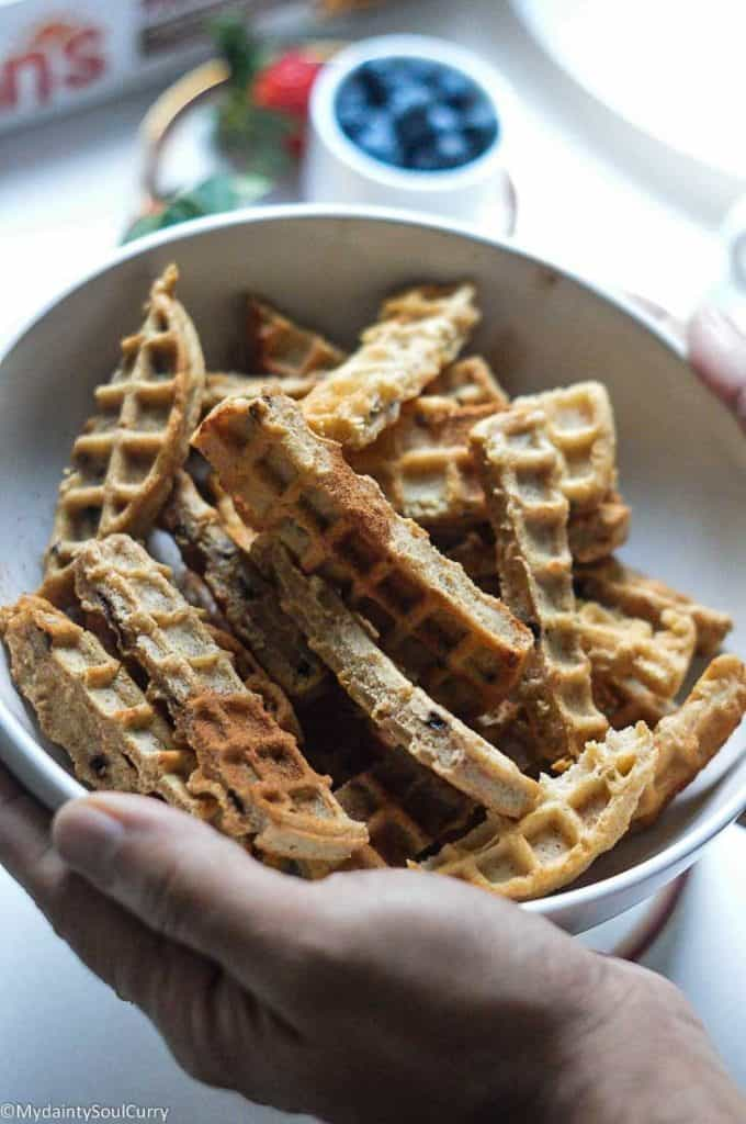 Tossing waffle sticks with cinnamon sugar
