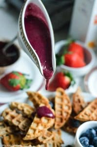 Berry compote sauce over waffle churros
